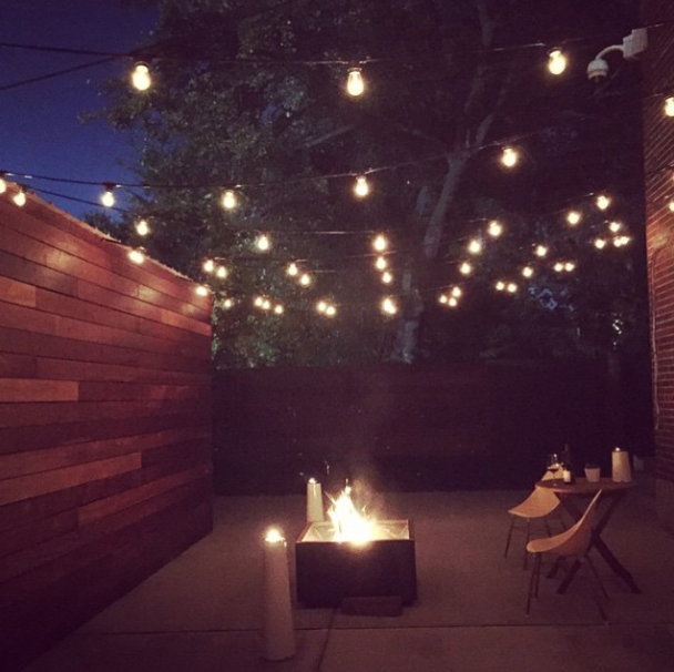 Outdoor patio lighting idea: link together strands of Edison bulbs for an urban chic feel. Super minimalist and delicate.